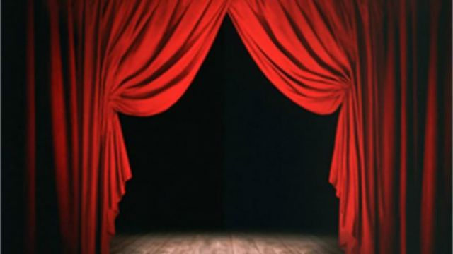 red stage curtains, open with black background