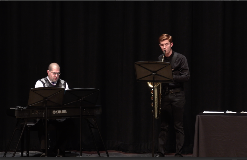 Beegan Melchiondo plays the baritone saxophone with Mr. Orecchio accompanies him on the piano